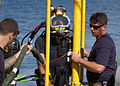 US Navy 060606-N-4205W-004 Chief Navy Diver Matthew Stevens and Navy Diver 1st Class Kevin Parsons stage handle Master Sgt. David Ling from the Republic of Singapore Navy (RSN) prior to conducting a dive.jpg
