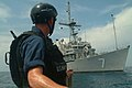 US Navy 060614-N-4124C-020 Mineman 2nd Class Simon S. Walters, assigned to the mine warfare ship USS Patriot (MCM 7), prepares to throw a line to his ship during mine-recovery operations.jpg