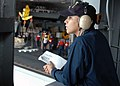 US Navy 060817-N-7047S-050 Engineman Fireman Jeyline Vargas relays messages between the 1st lieutenant and the bridge, while conducting an ammunition offload aboard the Nimitz-class aircraft carrier USS George Washington.jpg