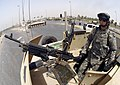 US Navy 060820-N-7590D-199 U.S. Army soldiers assigned to the 506th Regimental Combat Team, 101st Airborne Division assist the 6th Iraqi Army Division and Iraqi Police to secure the streets for Iraqi citizens.jpg