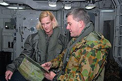 US Navy 070622-N-4124C-001 Brig. Gen. John G. Caligari, commanding officer of Royal Australian Army's 3rd Brigade and commander of Combined Force Land Component Command (CFLCC), and Rear Adm. Carol M. Pottenger, commander.jpg