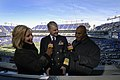 US Navy 071201-N-8273J-011 Chief of Naval Operations (CNO) Adm. Gary Roughead, center, conducts a pre-game interview with Baltimore CBS affiliate WJZ-TV Channel 13, prior to the 108th Army-Navy game at M^T Bank Stadium in Balti.jpg