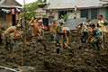 US Navy 080610-N-7498L-732 Seabees assigned to Naval Mobile Construction Battalion (NMCB) 133 and Armed Forces of the Philippines soldiers from the 546th Engineer Construction Battalion work together to dig a small trench.jpg