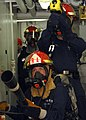 US Navy 080715-N-9134V-085 Sailors simulate firefighting techniques during a general quarters drill aboard the amphibious dock landing ship USS Carter Hall (LSD 50).jpg