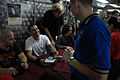 US Navy 080924-N-4005H-161 Scott Stapp , hands back a signed CD to Aviation Boatswain's Mate (Equipment) Airman Troy Cloe.jpg