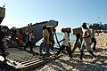 US Navy 080926-N-4515N-047 Haitian civilians unload relief supplies from a landing craft utility.jpg