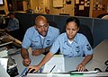 US Navy 081205-N-2147L-002 Information Technician 1st Class Larry Williamson assists Information Technician Taysha Colon at Naval Network Warfare Command.jpg
