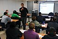 US Navy 090617-N-9610C-029 Chad Stober, an instructor at John C. Stennis University , center, teaches students Japanese in a training classroom aboard the Nimitz-class aircraft carrier USS John C. Stennis (CVN 74).jpg