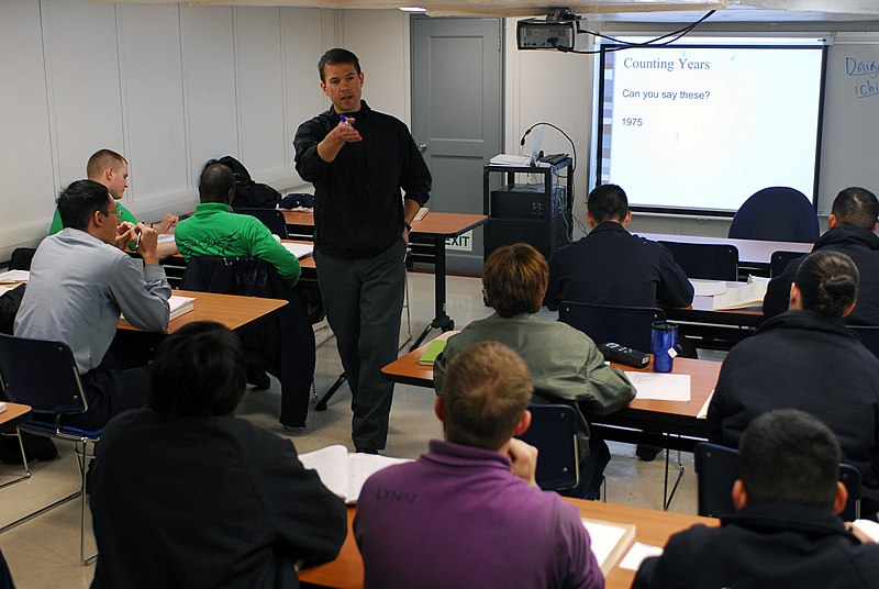 File:US Navy 090617-N-9610C-029 Chad Stober, an instructor at John C. Stennis University , center, teaches students Japanese in a training classroom aboard the Nimitz-class aircraft carrier USS John C. Stennis (CVN 74).jpg