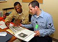US Navy 090708-N-9247P-012 Chief Legalman Joseph Brown, and Aviation Electrician's Mate 3rd Class Stephen Riggs, review new training material for USS Abraham Lincoln's (CVN 72) Legal Department.jpg