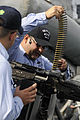 US Navy 090812-N-7498L-073 Anti-terrorism training team member, Gunner's Mate 1st Class Javier Villarreal, from Edinburg, Texas, loads an M-240 machine gun aboard the guided-missile destroyer USS O'Kane (DDG 77) as the ship pre.jpg