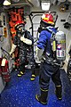 US Navy 100322-N-4774B-581 Logistics Specialist 2nd Class Proceso Mejia and Electrician's Mate Fireman Apprentice Kai Zhong participate in a general quarters drill aboard the guided-missile cruiser USS Bunker Hill (CG 52).jpg