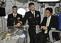 US Navy 100410-N-7282P-070 Capt. David A. Lausman, commanding officer of the aircraft carrier USS George Washington (CVN 73), explains the operations and function of flight deck control to Japan Minister for Foreign Affairs Kat.jpg