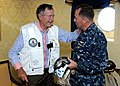 US Navy 100714-N-6632S-109 Former President George H.W. Bush speaks with Cmdr. William Pennington, executive officer of the aircraft carrier USS George H.W. Bush (CVN 77).jpg