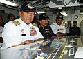 US Navy 100802-N-6632S-130 Adm. Tan Sri Abdul Aziz Jaafar and other officials look at a ouija board in flight deck control during a tour aboard USS George H.W. Bush (CVN 77).jpg
