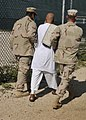 US Navy 101112-N-3887D-067 Sailors assigned to Navy Expeditionary Guard Battalion escort a detainee. Navy Expeditionary Guard Battalion provides 30.jpg