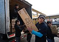 US Navy 110612-N-ZI300-043 Volunteers at a shelter for evacuees of an eruption of Mount Puyehue unload supplies and donations from Project Handclas.jpg