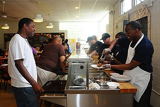 Hunger in the United States - Members of the United States Navy serving hungry Americans at a soup kitchen in Red Bank, N.J., during a community service project