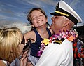 US Navy 110629-N-WX059-264 Lt. Donald Curran is greeted by his family after returning from a seven-month deployment.jpg