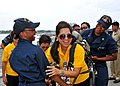 US Navy 110630-N-NJ145-013 Damage Controlman Fireman Apprentice Sharaine Robinson supports Becky Labit as dons a self contained breathing apparatus.jpg