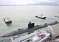 US Navy 110802-N-BE353-044 A pair of tug boats pull USS Santa Fe (SSN 763) away from USS Frank Cable (AS 40).jpg