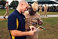 US Navy 111114-N-MF541-267 Rear Adm. Earl L. Gay, commander of Navy Recruiting Command, is shown information about pillar prep, a component of the.jpg