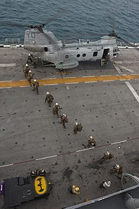 US Navy 111214-N-DX615-155 Marines embark a CH-46E Sea Stallion helicopter, assigned to the Red Dragons of Marine Medium Helicopter Squadron (HMM).jpg