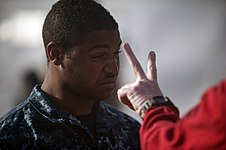 US Navy 120105-N-PB383-095 A Sailor holds up fingers to test vision.jpg