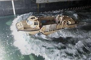US Navy 120127-N-KS651-215 A lighter amphibious re-supply cargo departs the welldeck of amphibious dock landing ship USS Pearl Harbor (LSD 52) duri.jpg
