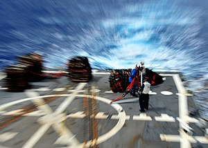 US Navy 120208-N-ED900-445 Flight deck personnel aboard the guided-missile destroyer USS Pinckney (DDG 91) prepare pallets to be lifted from the fl.jpg
