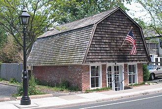 Sag Harbor, New York - Umbrella House, oldest house in Sag Harbor. It housed British troops in the American Revolution and was hit by cannon fire during the War of 1812 (where light colored bricks are in lower left corner).