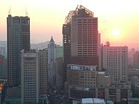 Urumqi partial panorama at dusk.JPG