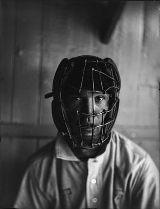 Catcher - A player wearing an old-fashioned catcher's mask.