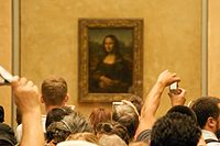 Visitors viewing Mona Lisa at the Louvre 2009-08-06 .jpg