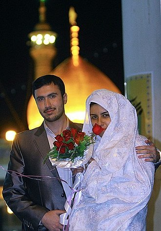 Collective wedding - A Shi'a Muslim wedded couple pictured in Fatima Masumeh Shrine, Qom, Iran on 30 October 2011 during a mass wedding ceremony arranged on occasion of Fatima Zahra and Ali ibn Abi Talib's wedding anniversary.
