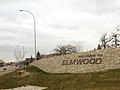 Welcome to Elmwood sign on embankment in Winnipeg, Manitoba.jpg
