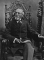 Whitelaw Reid seated circa 1898.png