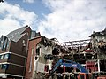 Wrecked house (218559642).jpg