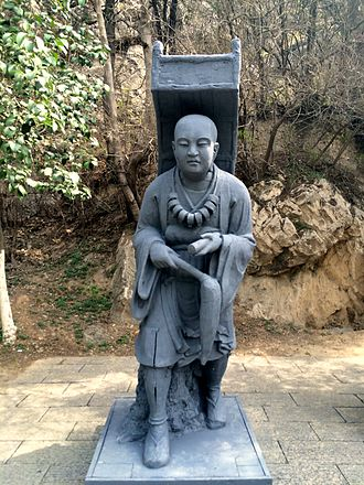 Yogachara - Statue of a traveling Xuanzang at Longmen Grottoes, Luoyang.
