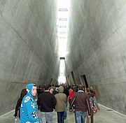 Interior of the Holocaust History Museum; the main triangular walkway connects the  museum's exhibition halls.