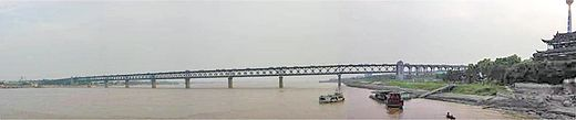 The First Bridge at Wuhan. This view is upstream, toward the distant Three Gorges and Chongqing. YangtzeWuhanFirstBridge.jpg