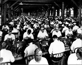 Cigar - Inside an Ybor City cigar factory c. 1920