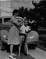 (Woman and girl in front of car holding a fish) (AM 81097-1).jpg
