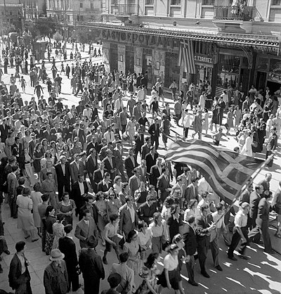 People in Athens celebrate the liberation from the Axis powers, October 1944. Postwar Greece would soon experience a civil war and political polarization. Αθηναίοι γιορτάζουν την απελευθέρωση της πόλης τους, Οκτώβριος 1944.jpg