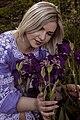 День Вишиванки. Молода україночка у вишитій синій сукні серед квітів 17.jpg