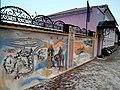 Забор с наглядной исторической росписью - panoramio.jpg