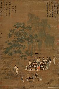 Twelve people gather around an outdoor table decorated with a black tablecloth, several potted plants, and dozens and dozens of small dishes. Most of the people are talking with one another. Off to the side a servant stands watching, and in the bottom of the painting four people are crowded around a smaller table set up as a staging area for the preparation of tea.