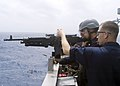 090701-N-1251W-075 - A midshipman from the Japan Maritime Self-Defense Force fires an M-240 machine gun from the bridge wing of the guided-missile cruiser USS Shiloh (CG-67).jpg