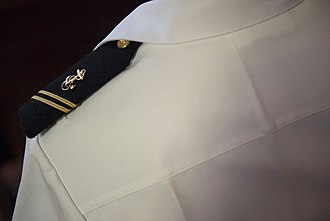 Shoulder mark - Firm shoulder board, with two small white loops on the shirt for fixing