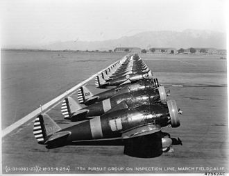 March Air Reserve Base - Boeing P-26A Peashooters of the 17th Pursuit Group, 18 February 1935. 33–102 sits in the foreground. These aircraft were later sent to the 1st Pursuit Squadron/Group of Philippine Air Force in 1937.